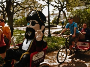 Captain George hitches a ride in Johnson Square.