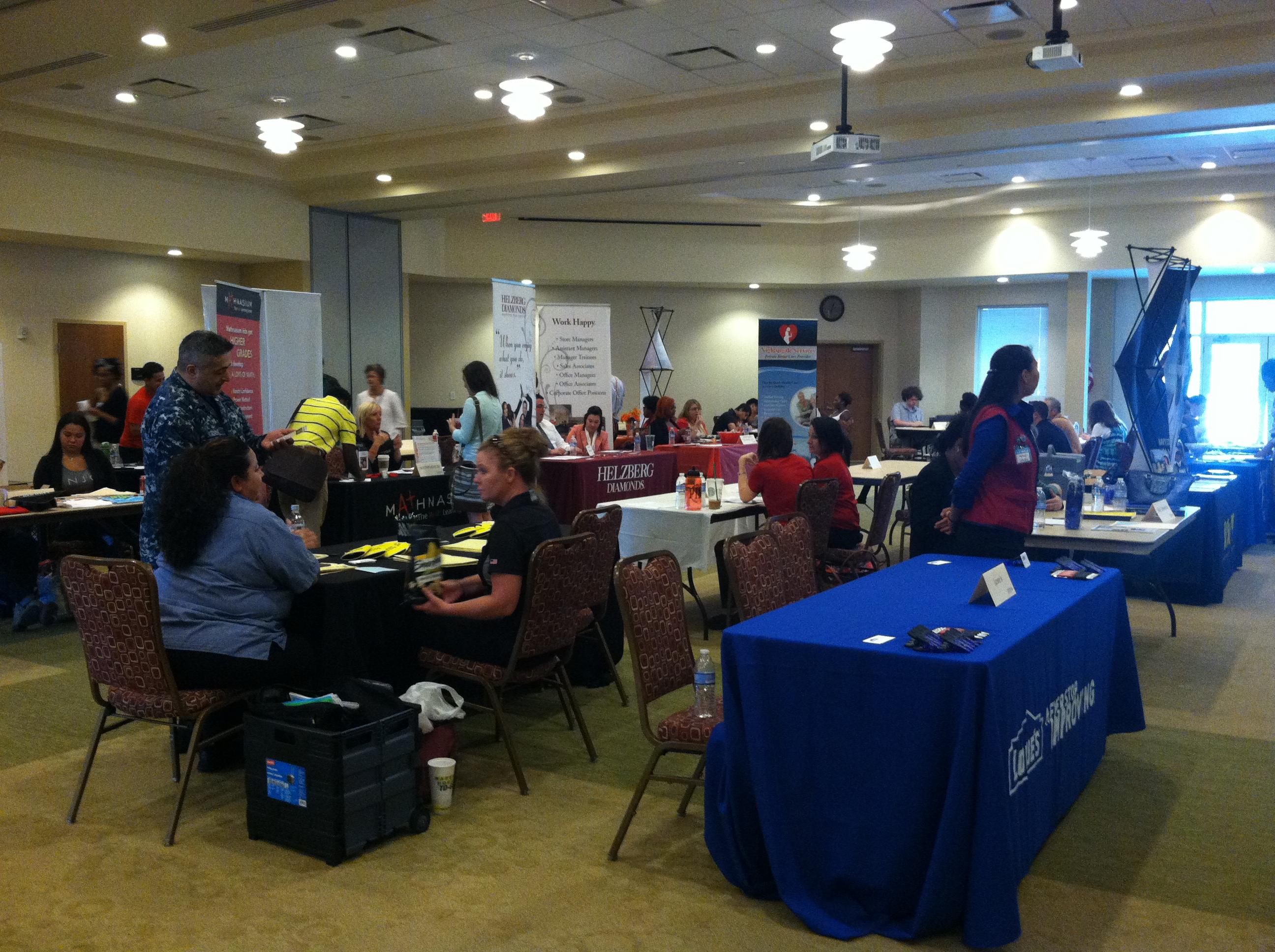 students evaluate job options at asu s career fair