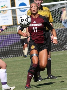 Taylor Russell dribbles the ball in match against Cougars.