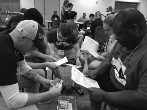 Group fills out paperwork at the poverty simulation