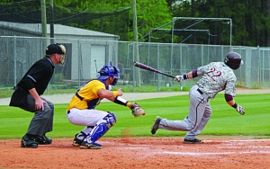 Baseball Picture  -Junior Cody Sherlin strokes a hit-  (Elizabeth Reid)