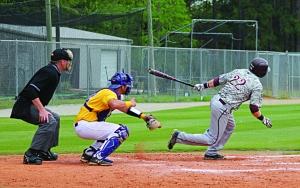 Baseball Picture  -Junior Cody Sherlin strokes a hit-  (Elizabeth Reid)