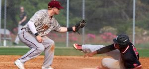 Senior Cody Sherlin attempts to tag out a sliding Columbus State Cougar in the loss over the weekend. The Pirates went the entire season only winning on series in Peach Belt play. - Saturday, April 23 (Armstrong Communications)