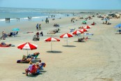 Despite concerns, Tybee Island will not be banning alcohol on the beach. Photo via publicdomainpictures.net