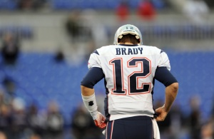 New England Patriots quarterback Tom Brady walks off the field during a 2015 game. He will serve his four-game suspension, originally scheduled for last season, to open the 2016 season. (USA TODAY Sports)
